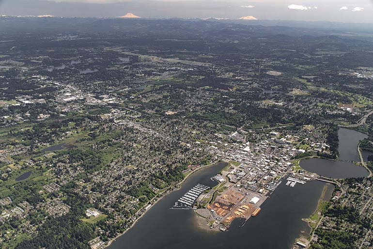 The aerial photo includes portions of Lacey, Olympia, and Tumwater in Thurston County, Washington