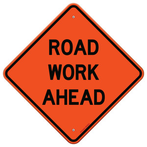 Orange road work ahead signage