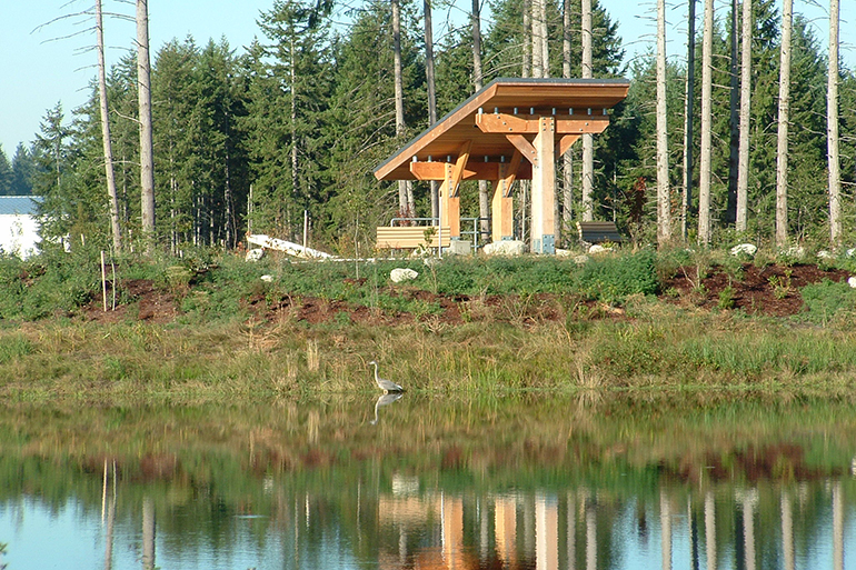 Kiosk and reclaimed water pond at LOTT's Hawks Prairie Ponds site in Lacey, Washington