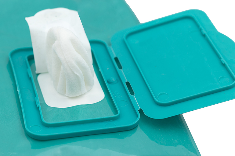 Wet pop-up wipes in an opened container