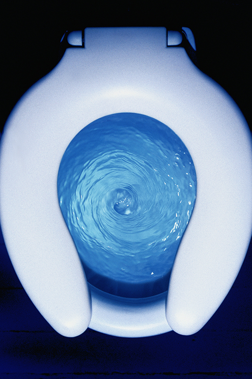 Top view of a toilet flushing