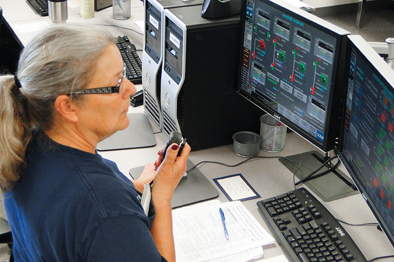Wastewater Operator at a control station.