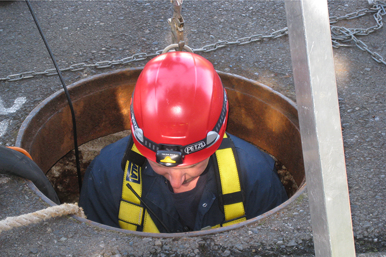 LOTT staff doing a confined space entry into manhole